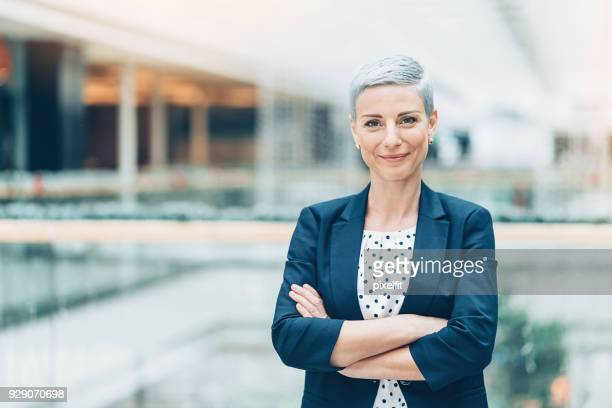 portrait of a businesswoman - employment law stock photos and pictures