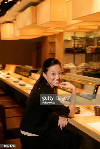 Portrait of a businesswoman sitting at a cafeteria counter