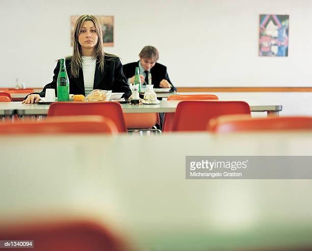Portrait of a Businesswoman Sitting at a Table in a Canteen