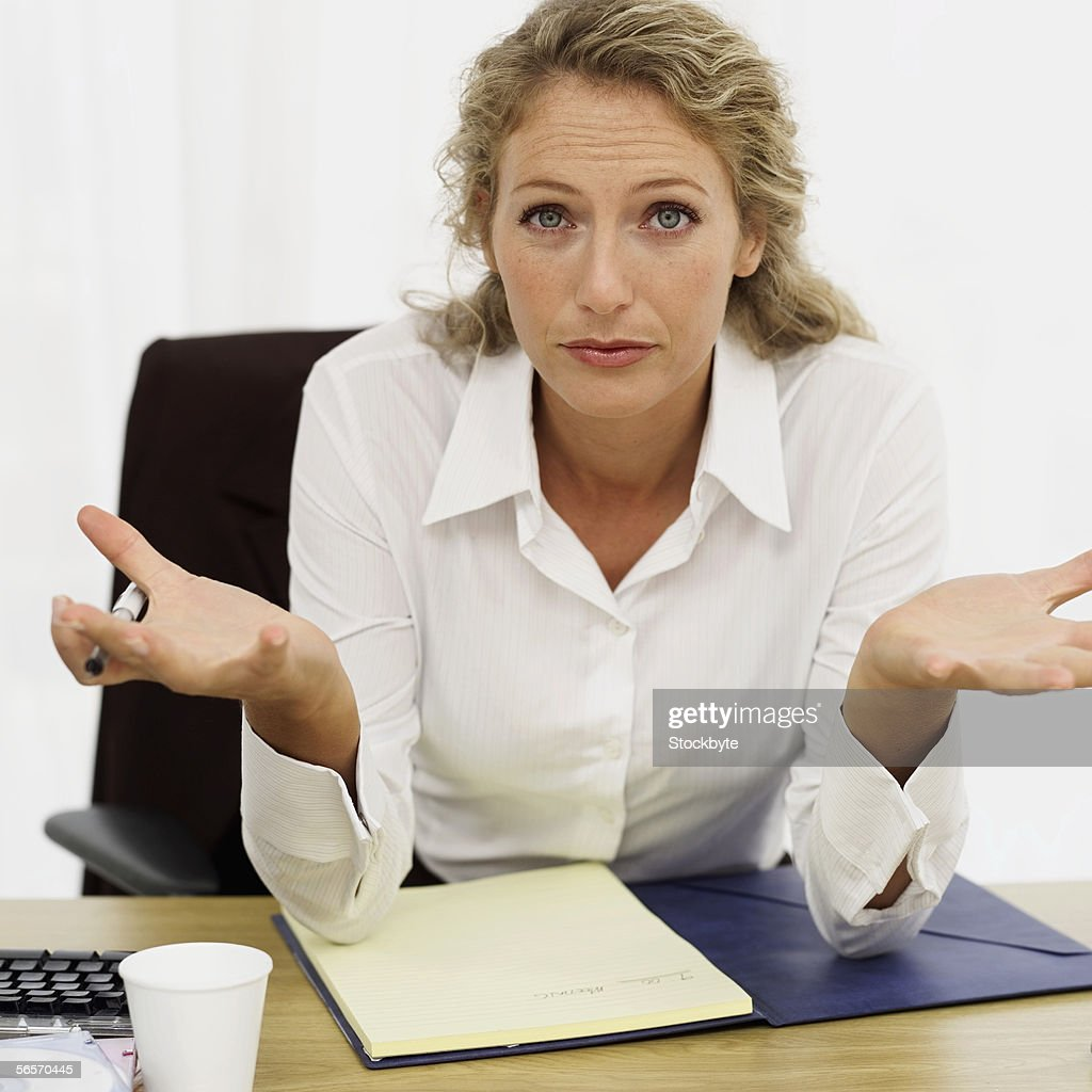 portrait of a businesswoman sitting in an office : Stock Photo
