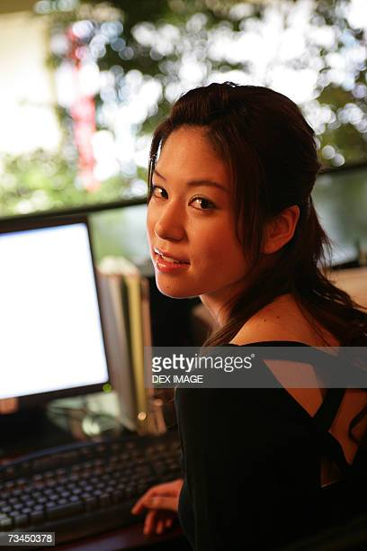 Portrait of a businesswoman sitting in front of a computer in an office