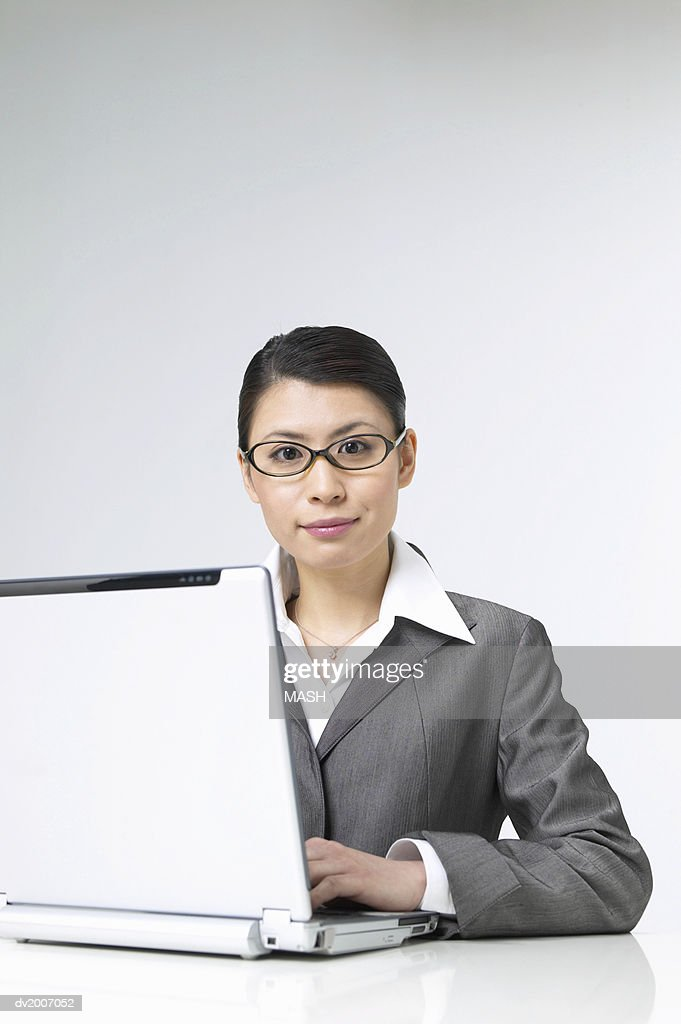 Portrait of a Businesswoman Sitting With a Laptop : Stock Photo