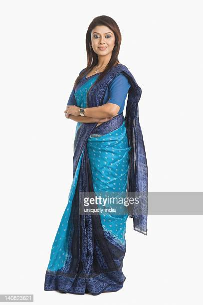 portrait of a businesswoman standing with her arms crossed - sari stock pictures, royalty-free photos & images