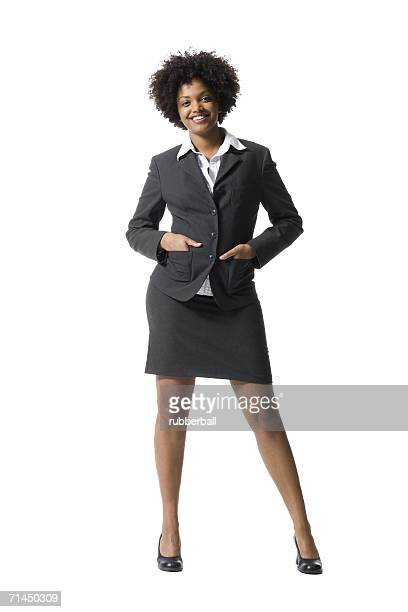 portrait of a businesswoman standing with her hands in her pockets - black skirt stock pictures, royalty-free photos & images