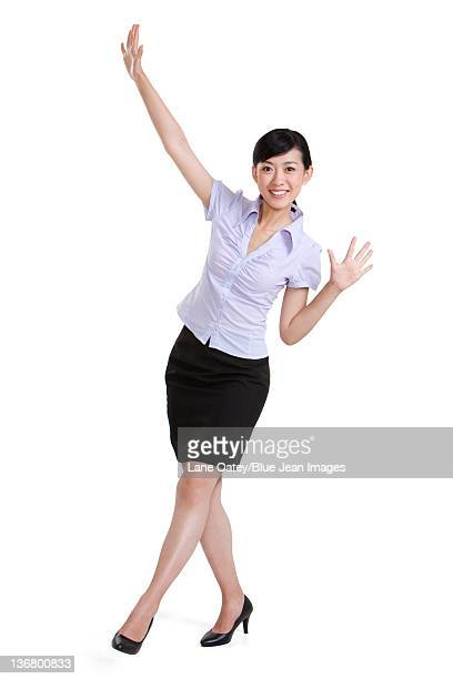 portrait of a businesswoman waving - short sleeved stock pictures, royalty-free photos & images