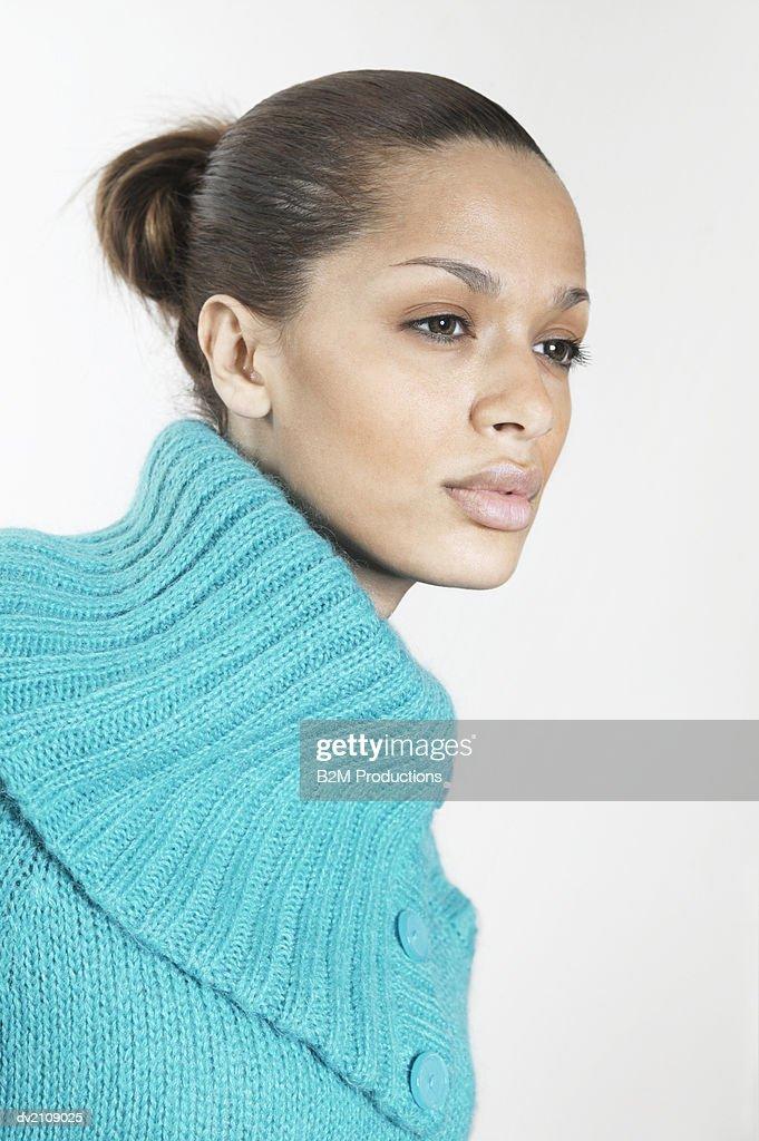Portrait of a Businesswoman Wearing a Blue Woolen Top : Stock Photo