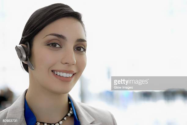 Portrait of a businesswoman wearing a hands free device and smiling