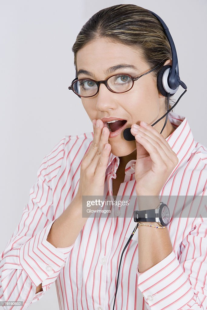 Portrait of a businesswoman wearing a headset and looking surprised : Stock Photo