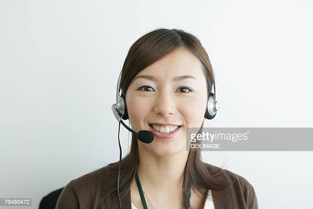Portrait of a businesswoman wearing a headset and smiling