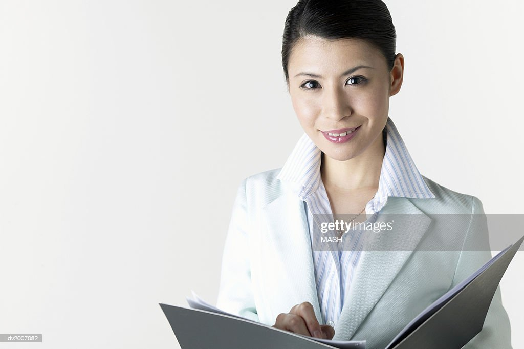 Portrait of a Businesswoman With a Folder in Her Hands : Stock Photo
