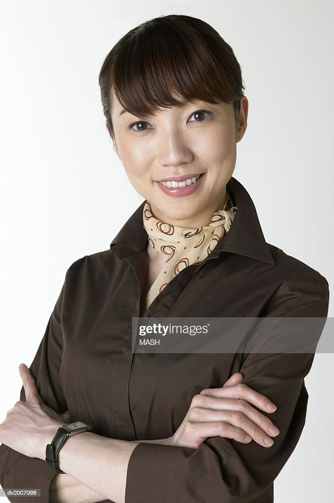 Portrait of a Businesswoman With Her Arms Crossed : Stock Photo