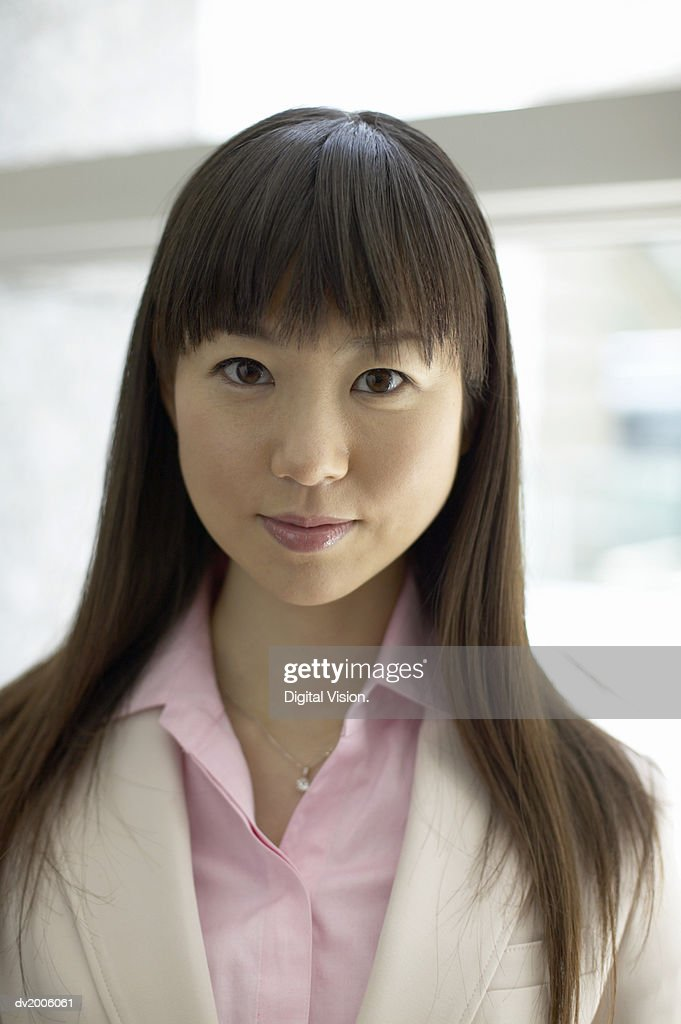 Portrait of a Businesswoman With Long, Black Hair : Stock Photo