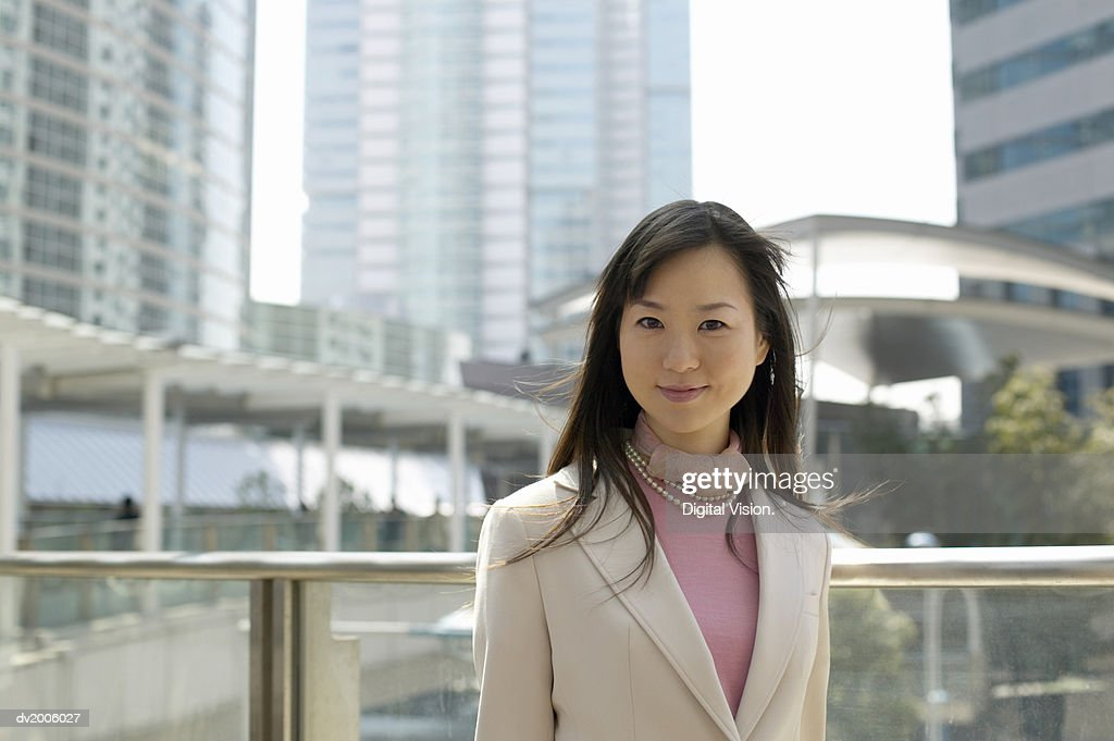 Portrait of a Businesswoman with Office Blocks in the Background : Stock Photo
