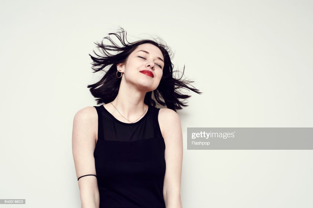 Portrait of a carefree young woman : Stock Photo
