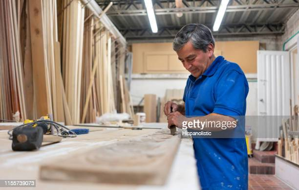 portrait of a carpenter carving wood - marquetry stock photos and pictures
