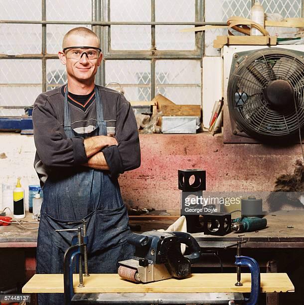 portrait of a carpenter standing in a workshop