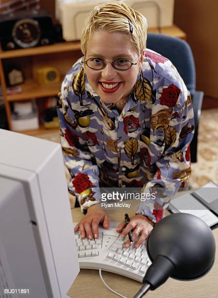Portrait of a Casual Businesswoman at a Computer