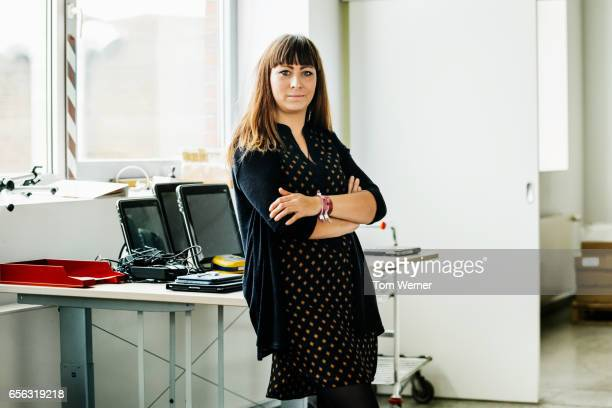 Portrait of a casual businesswoman standing in an office