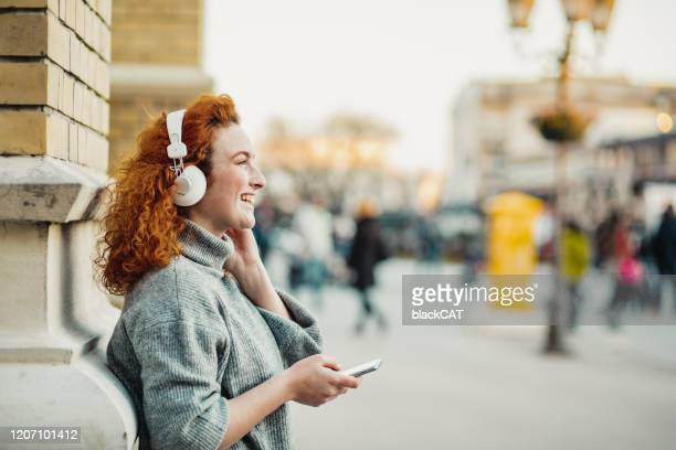 portrait of a casusal young woman - podcasting stock pictures, royalty-free photos & images