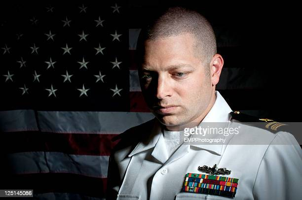 portrait of a caucasian naval officer with american flag - us navy stock pictures, royalty-free photos & images