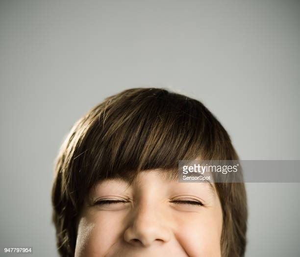 Portrait of a caucasian real boy with closed eyes.
