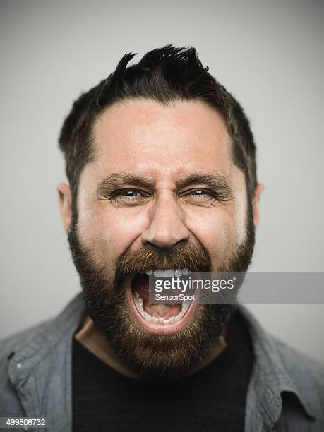 portrait of a caucasian real young man - shouting stock photos and pictures