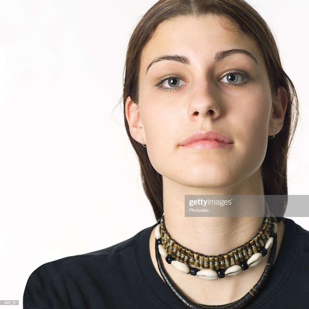 portrait of a caucasian teenage girl in a black shirt looks seriously into the camera : Stock Photo