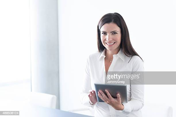 Portrait of a Caucasian woman with digital tablet