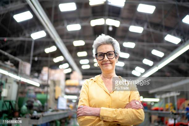 portrait of a ceo businesswoman in the industry - chief executive officer stock pictures, royalty-free photos & images