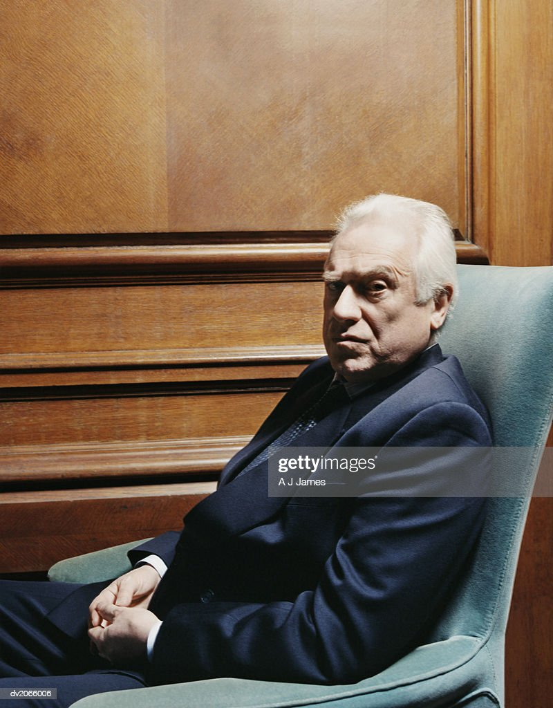 Portrait of a CEO Sitting in an Armchair : Stock Photo