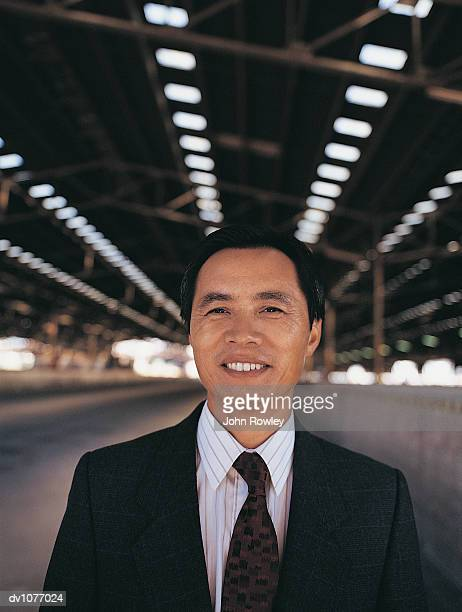 Portrait of a CEO Standing in a Factory