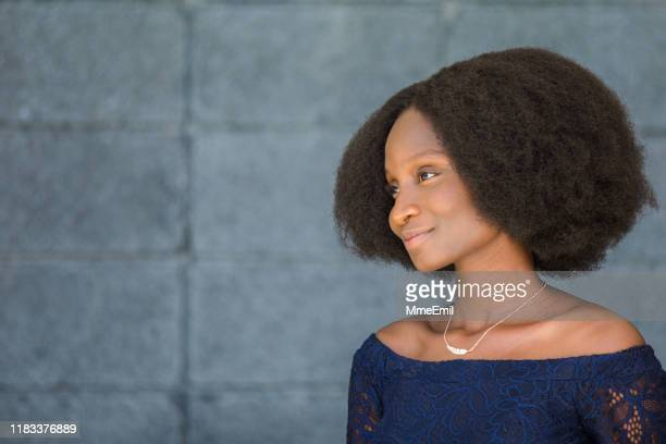 portrait of a cheerful african-american woman with an afro, profile - mmeemil stock photos and pictures