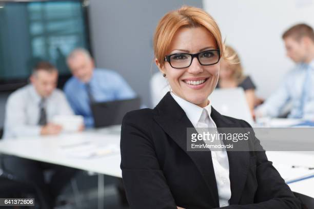 Portrait of a cheerful businesswoman at the office.