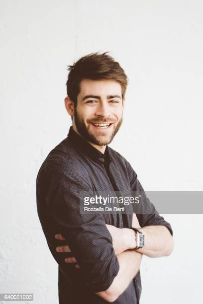 portrait of a cheerful young man - front view photos stock photos and pictures