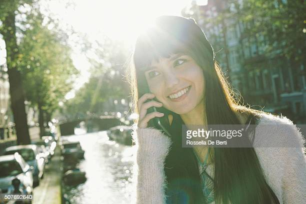 Portrait Of A Cheerful Young Woman On The Phone