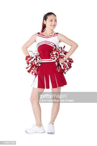 portrait of a cheerleader in red - asian cheerleaders stock photos and pictures