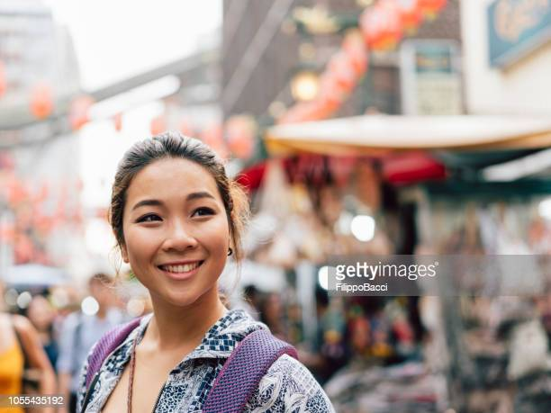 portrait of a chinese young adult woman in chinatown - chinese culture stock pictures, royalty-free photos & images