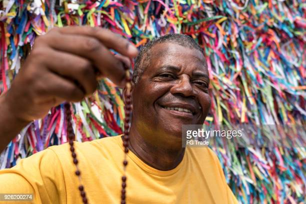 portrait of a christian man showing the crucifix - bahia state stock pictures, royalty-free photos & images