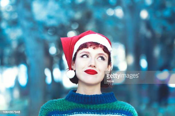 portrait of a christmas woman - santa face stock photos and pictures