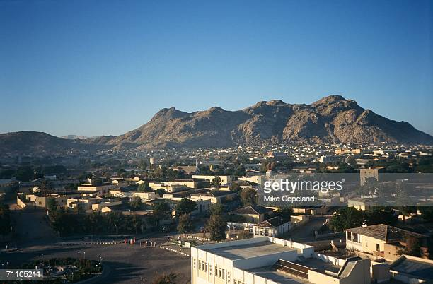 portrait of a city against a mountain - eritrea stock pictures, royalty-free photos & images