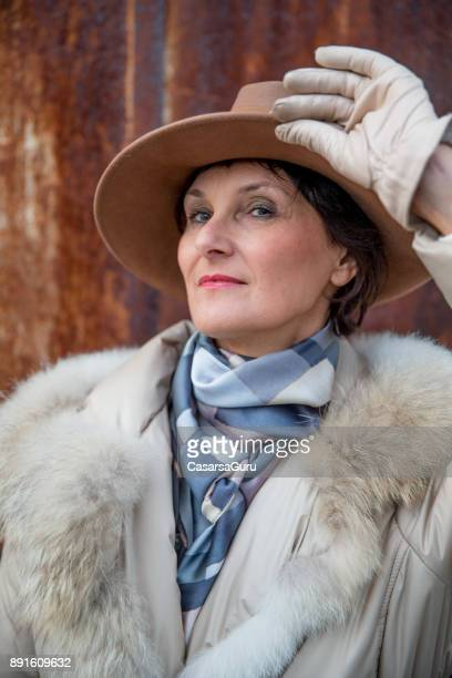Portrait of a Classy Mature Woman Against Rusty Background