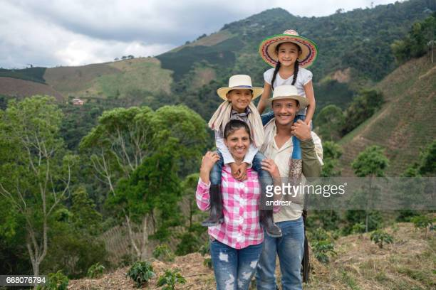 portrait of a colombian family of farmers at the countryside - farm worker stock pictures, royalty-free photos & images