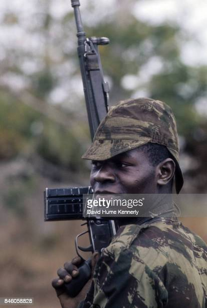 Portrait of a Colonial Portuguese soldier as he holds his rifle during the Mozambican War of Independence Ancuabe Cabo Delgado Province Mozambique...