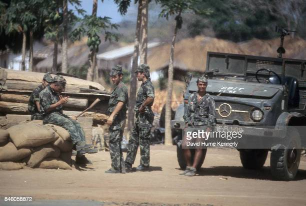 Portrait of a Colonial Portuguese soldiers and a machine gun truck stationed near the airport during the Mozambican War of Independence the Nangade...