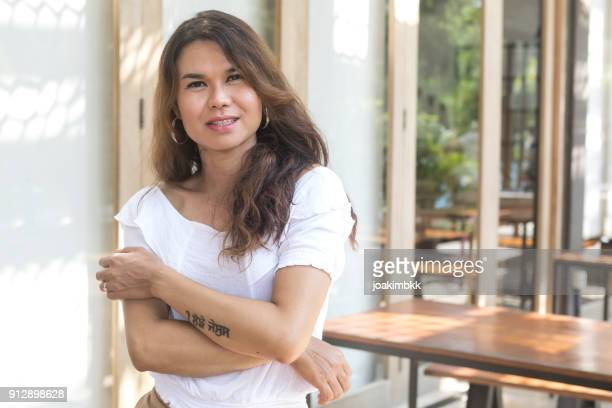 portrait of a confident and cheerful asian male transgender - transgender woman stock photos and pictures