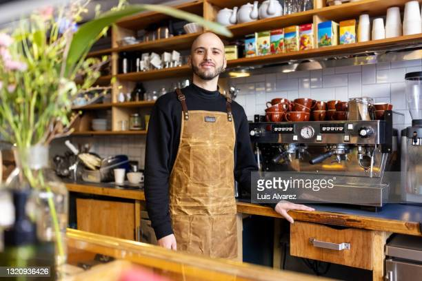 portrait of a confident and successful small coffee shop owner - 35 39 years stock pictures, royalty-free photos & images