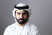 Portrait Of A Confident Arab Businessman Wearing UAE Emirati Traditional Dress