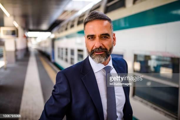 portrait of a confident businessman. - full suit stock pictures, royalty-free photos & images