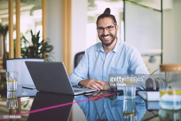 portrait of a confident businessman - man bun stock pictures, royalty-free photos & images