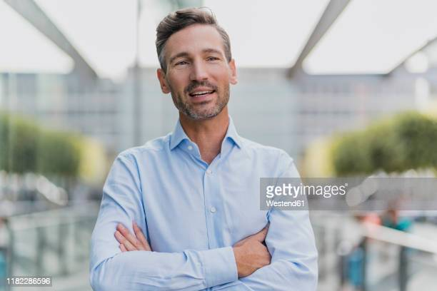 portrait of a confident businessman - one man only stock pictures, royalty-free photos & images